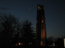 Night view of Moser Tower and Millennium Carillon in Riverwalk Park in downtown Naperville