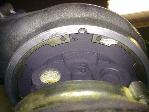 3- Remove the large snap ring that holds the compressor housing to the center section. Remove the compressor housing.