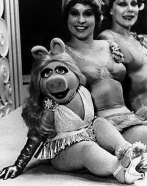 Miss Piggy with synchronized swimmers on set of The Great Muppet Caper.