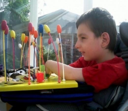 Joe enjoys sensory Lollipop Jungle on a Trabasack play tray