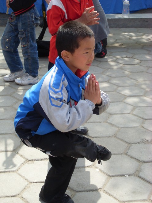 A young boy showing off his Kung Fu skills.