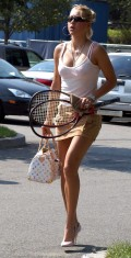 Anna with her Louis Vuitton and tennis racquets.