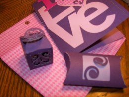 Valentine card with envelope and gift boxes.