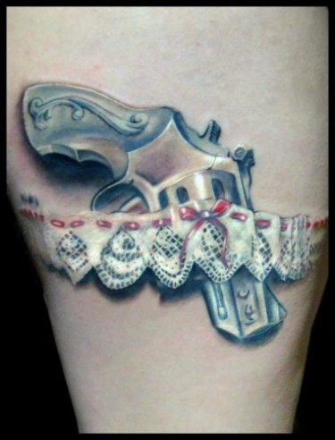 One of the best done garter & gun tattoos, perfect shadowing and realism.