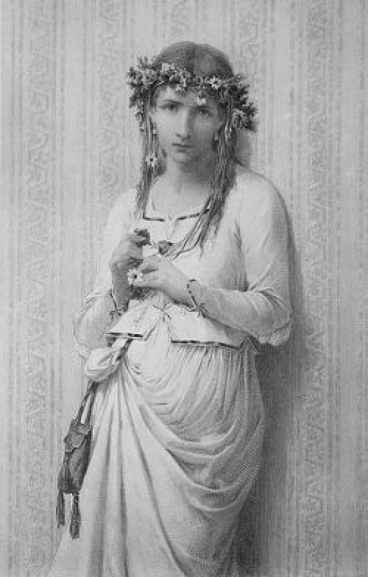 Ophelia wears a crown of flowers in her messy hair