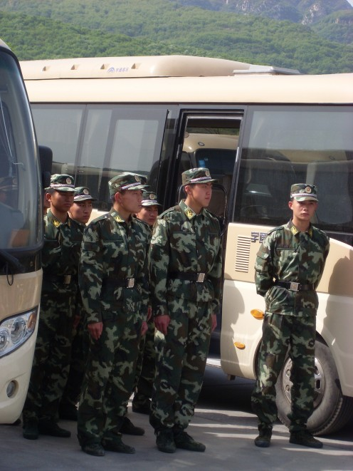 Soldiers guarding the tour buses.