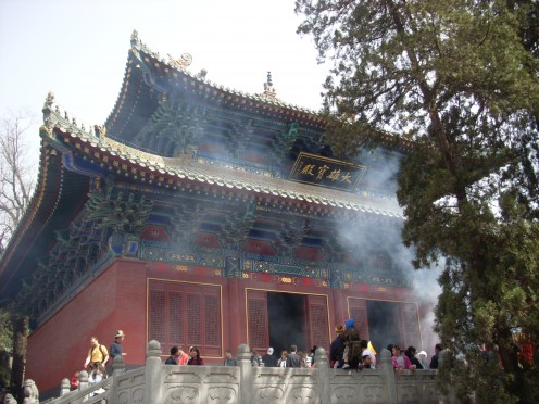 Smoke from the incense being burnt at the main part of the temple.