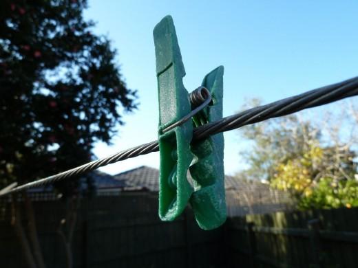 photo clothes peg washing line green garden blue sky