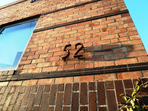 Sun-kissed house number in Clifton Hill.