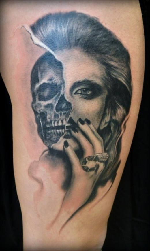 Half skull, half girl tattoo.  Source: http://imgur.com/r/tattoos/dTTgf