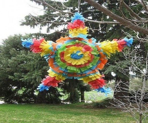 Star Pinata hanging from tree.