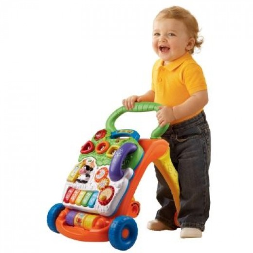 Youngster Having Some Fun with the VTech Toy Panel & Walker.