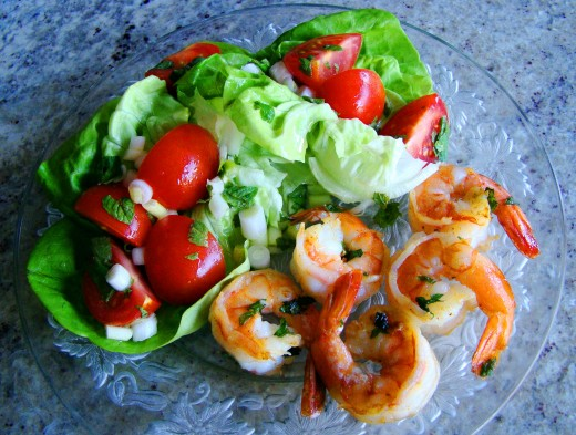 Grilled seasoned shrimp with a Greek salad. Toss the greens with feta cheese and an oily Greek dressing. Scrumptious!