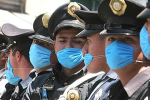 Mexican police with masks ready to assist with quarantining of citizens...