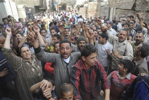 Egyptian farmers block roads to prevent government from slaughtering their pigs