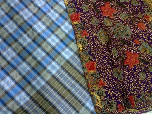 A kain pelikat for guys and a batik sarong for ladies.
