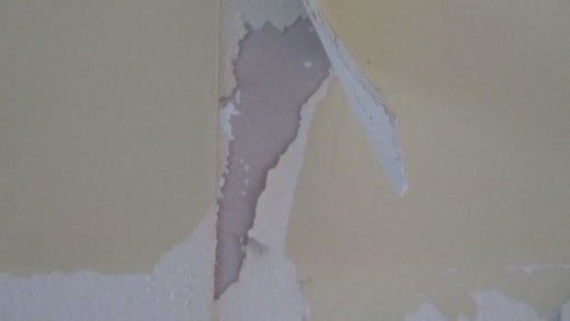 Indication of flaky paint underneath wallpaper