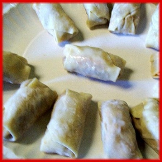Finished raw pizza rolls ready to be deep fried.