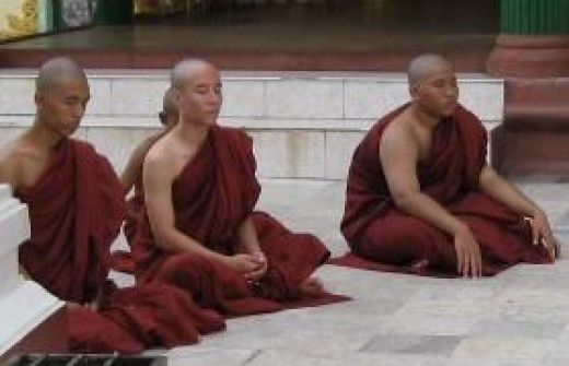 Three senior monks in their reddish brown robes
