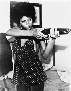 Pam Grier's got some guns