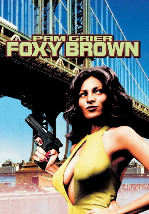 Foxy Brown in yellow catsuit and long flowing hair.