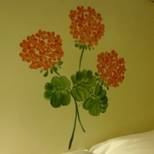You will find this image all over. This one is on the headboard of a double bed in one of the rooms.