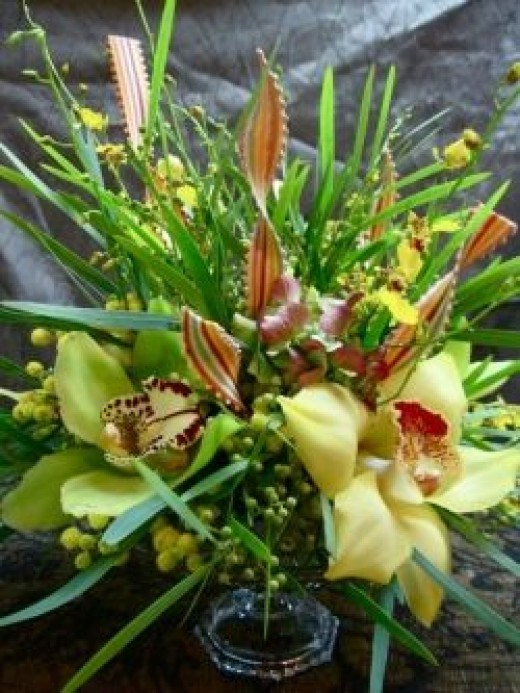 """This arrangement was part of a """"breakaway"""" or """"tablescape"""" for a dinner party. This refers to a collection of smaller arrangements which can be clustered together or separated and spread along the table, giving you lots of options for placement."""