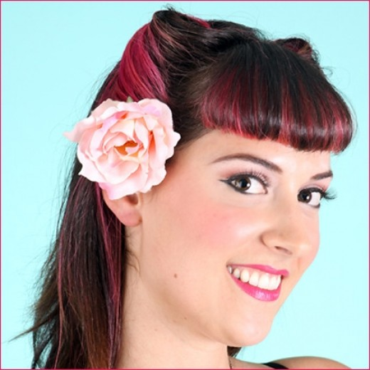 Add a touch of femininity to your retro hairdo with a floral hair clip, such as a rose