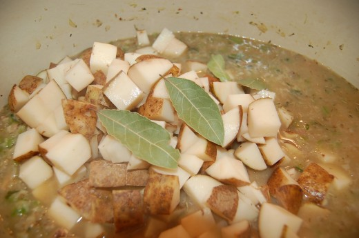 Add Potatoes and Bay Leaves
