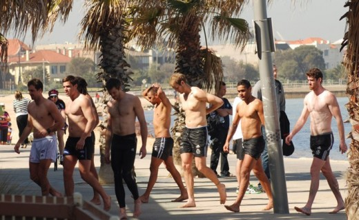 The Collingwood boys heading back into the gym facilities at the St Kilda Sea Baths. No, I can't imagine why they stop traffic either.