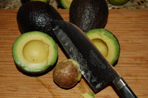Cutting and pitting Avacados for Homemade Spicy Guacamole Recipe