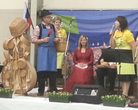 Visitors of Sodrazica, performing on stage (about Wooden Ware of Ribniska Dolina - Slovenia)