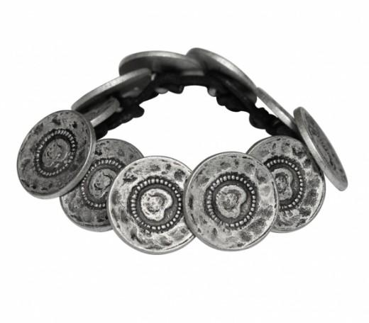 Fair-trade bracelets made from handmade metal buttons