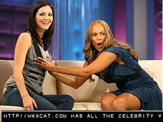 Tyra Banks was wondering if Katharine McPhee's Boobs were real or not and then Tyra Banks reaches over and feels her up.