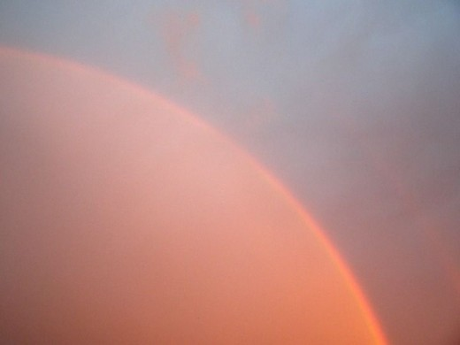 #79 (Rainbows) This rainbow was over our house on Tues. April 21,2009 I was even more beautiful in real life
