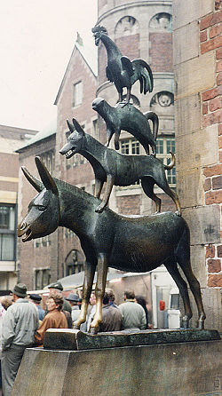 """A bronze statue depicting the Bremen Town Musicians located in Bremen, Germany. The statue was erected in 1953. Note the front hooves that have become shiny. Touching the front hooves is said to make wishes come true.""  http://en.wikipedia.org/wiki/"