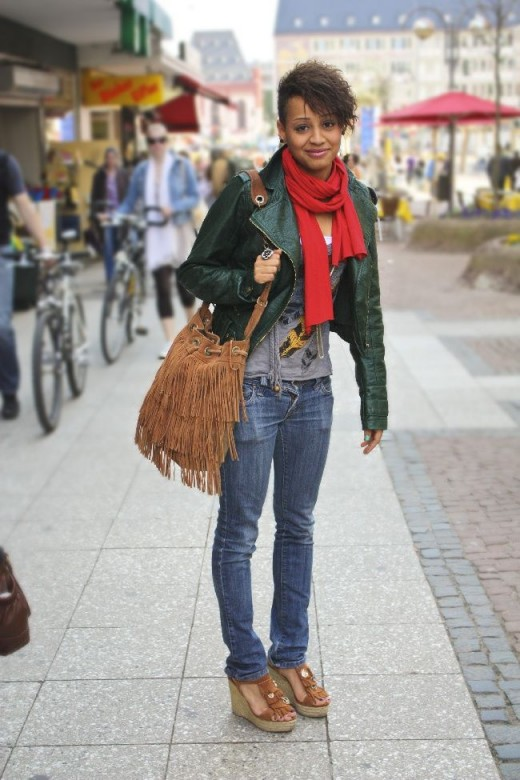 Simple street style with red scarf, business jacket and brown leather handbag with trimmings and blue jeans.