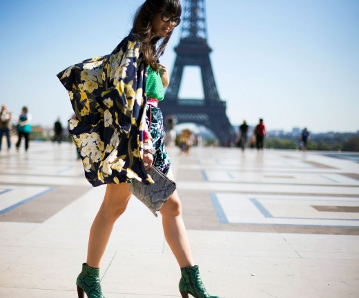 Very colorful street fashion, green alligator stiletto shoes and very colorful flowers on blouse jacket.