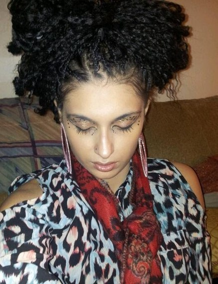 Vichnacova model wearing a braided Afro with zebra colored blouse and red scarf, long Bamboo earrings street style.