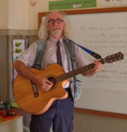 Bard of Ely sings and plays to the class