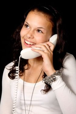 This Beautiful image is called Woman With Phone Smiling.