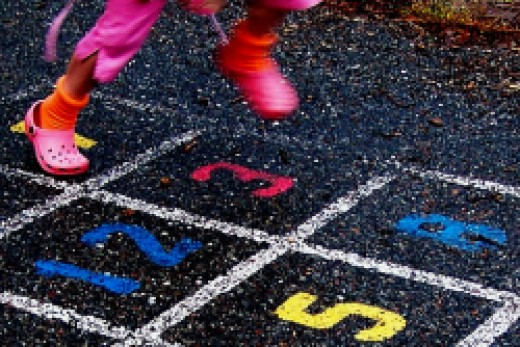 Happy Girl Hopscotch (CC BY 2.0) By Pink Sherbet Photography