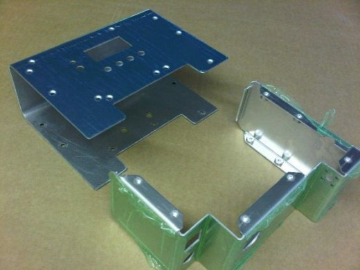 Sheet metsl work, chassis and cover to enclosure electronics used for a LED light fitting.
