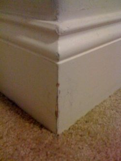 Example of Baseboard Corner Damage from Vacuum Scratches and Furniture Bumps