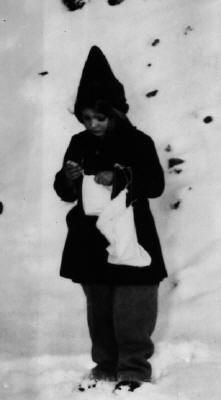Young girl with one of the candy bags dropped over West Berlin