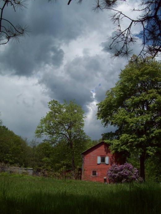 Summer storm building over a New Paltz barn.