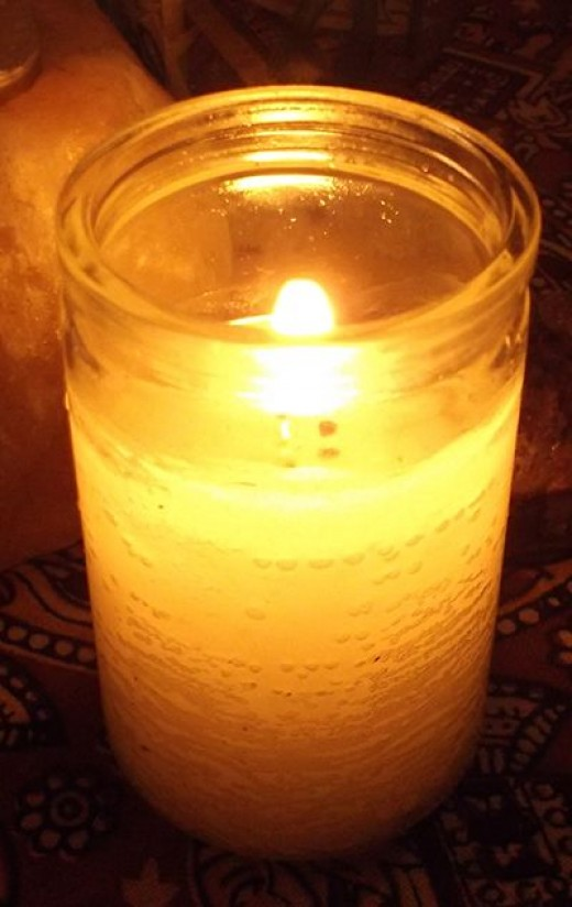 A candle on my table. Candles not only shed light, but symbolize (and help provide) wisdom and light to the situation being discussed.