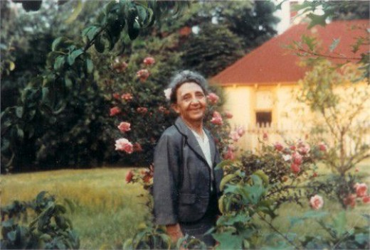 This is Babcia in the rose garden, in the back yard of the 200 year old house I grew up in, Staten Island, NY (Neighbor's workshop in background.)