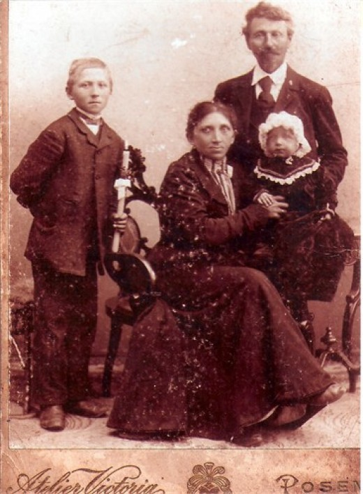 Babcia as a baby with her parents and stepbrother. 1904 The resemblance between my great-grandmother and my aunt is amazing.