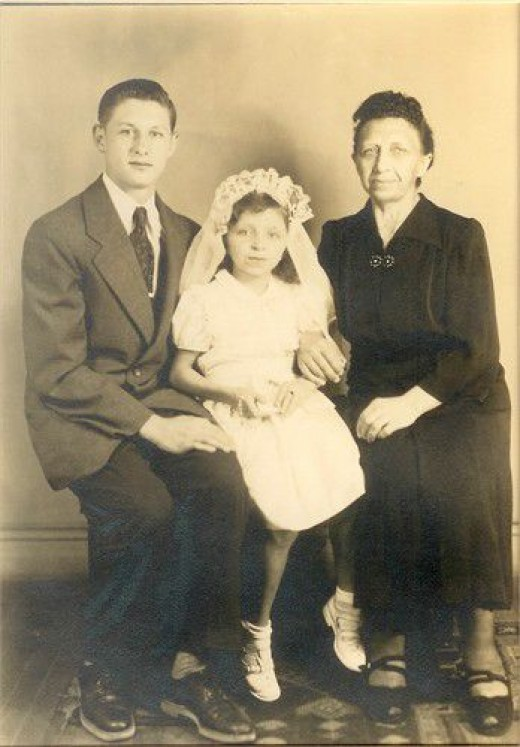 Dad, his sister and Babcia, 1953, right about the time he had his first job as a printer's apprentice.